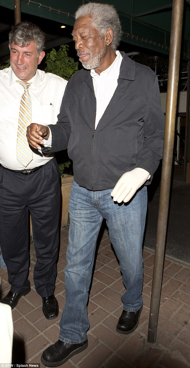 Still suffering: Morgan Freeman wore a compression glove on his left hand on Wednesday as he left West Hollywood restaurant Madeo. The hand was paralyzed from a car crash in 2008