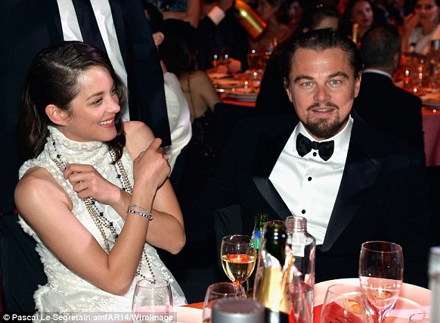 Talking shop? Oscar winner Marion Cotillard appeared amused as she sat beside five-time Oscar nominee Leonardo DiCaprio