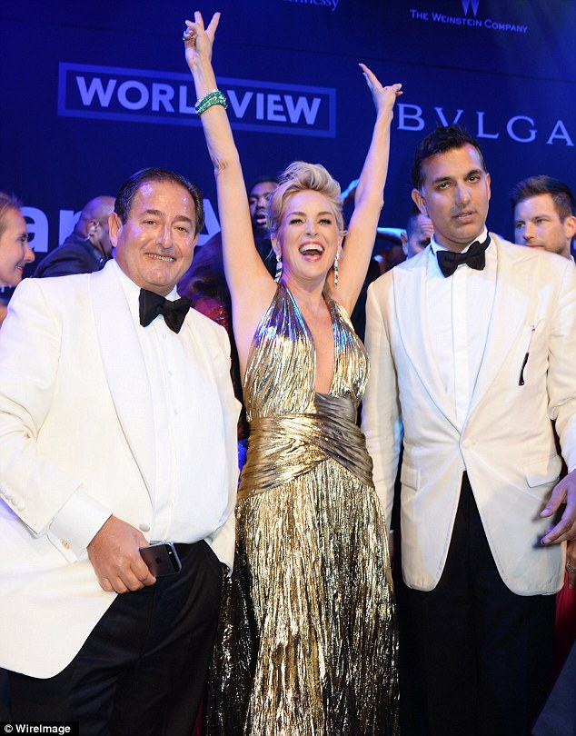 Let's celebrate: Sharon raises her arms in joy at the event in Cannes on Thursday evening