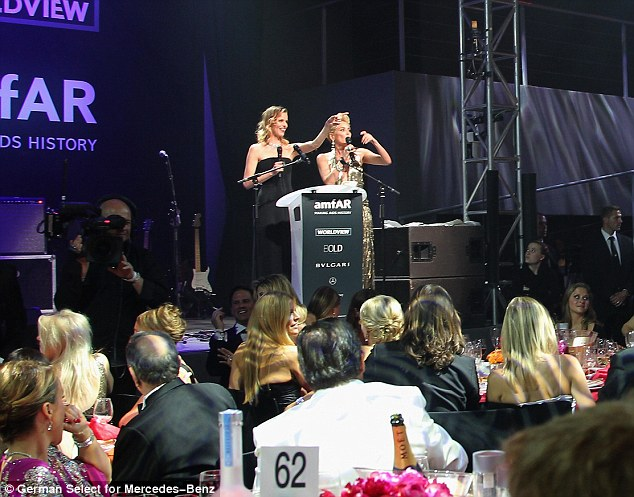 Leading lady: amFAR ambassador Sharon takes to the stage during the annual dinner and auction