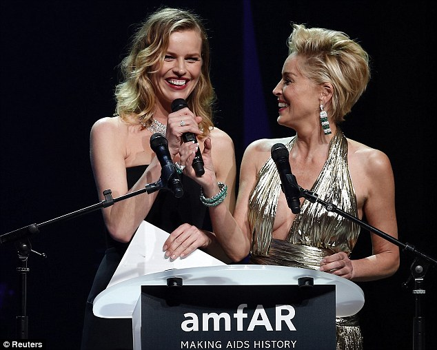 My turn: Czech model Eva Herzigova takes the microphone from Sharon Stone