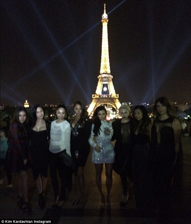 Center of attention: The ladies took a photo in front of the iconic Eiffel Tower