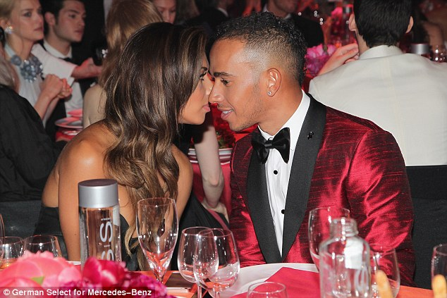 Happier than ever: Lewis Hamilton and Nicole Scherzinger put on a very  and loved-up display as they cosied up at the annual amfAR Cinema Against AIDS gala
