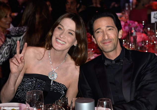Peace out: Actor Adrien Brody was sat beside former French first lady Carla Bruni
