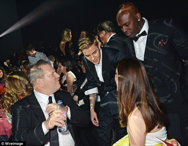 Doing the rounds: Justin looked in good spirits as he went to say hello to Lana Del Rey