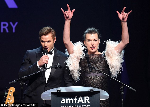 Rock out: Kellan Lutz was joined by a feathered Milla Jovovich on stage to talk