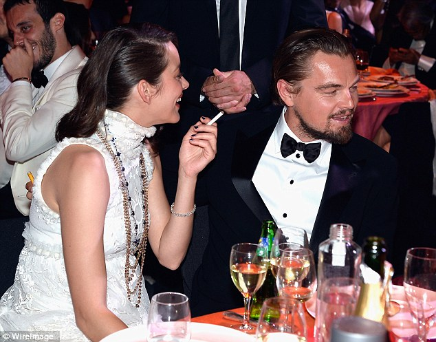 Enjoying the view: Leonardo DiCaprio, who was sat with Marion Cotillard no doubt enjoyed watching the models