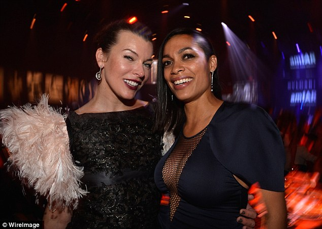Hanging out: Milla Jovovich (L) and Rosario Dawson enjoyed a catch-up at the gala