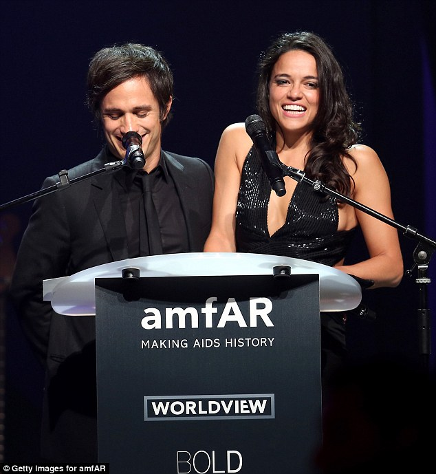 Giggles  Gael Garcia Bernal (L) and Michelle Rodriguez who had let her hair done spoke speak onstage )