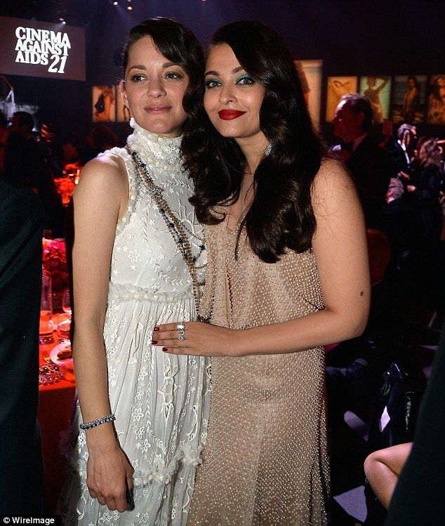 Ladies of the silver screen:Marion Cotillard and Aishwarya Rai cosied up for a snap