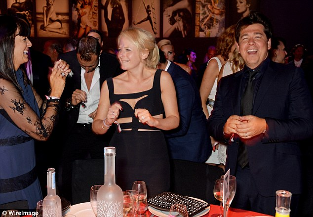 Unexpected guests: (L to R) Claudia Winkleman, Kitty McIntyre and Michael McIntyre were seen dancing at their table