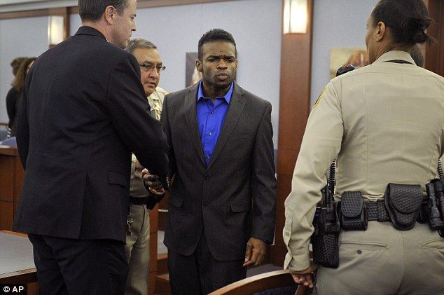 Goodbye mom: Jason Omar Griffith, (center), blows a kiss to his mother before being lead away and after a guilty verdict was read during his murder trial at the Regional Justice Center on Thursday, May 22, 2014, in Las Vegas