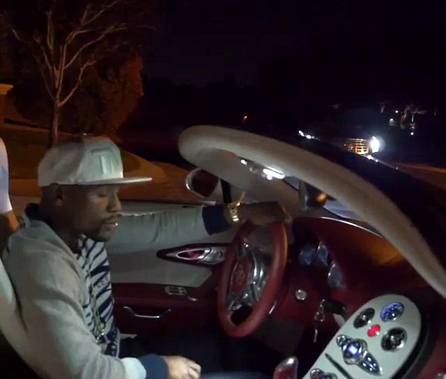 Chilling out: Floyd Mayweather posted a video of himself cruising around in a new Bugatti Veyron