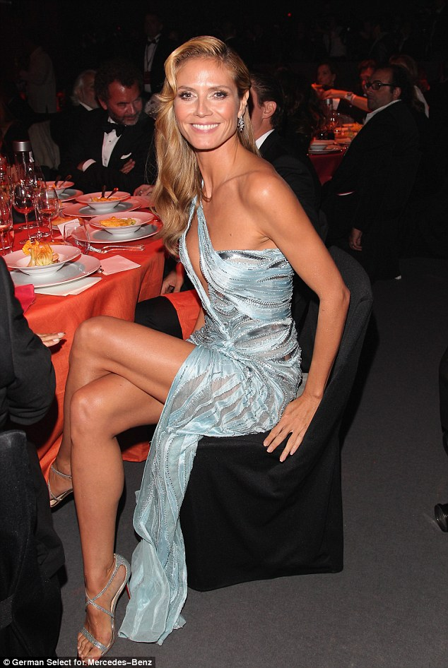 The thigh life: Heidi was sure to keep Vito's attention as she sported a flesh-baring silver-blue gown for the prestigious event