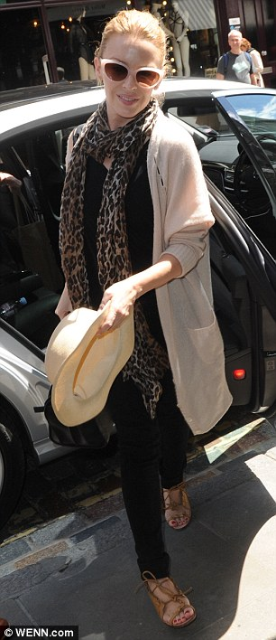 Jet-set look: Ditching her red carpet glamour in favour of a comfortable slouchy cardigan and skinny jeans, the pop princess would no doubt be looking forward to a well-earned break after attenting countless parties over the past few days