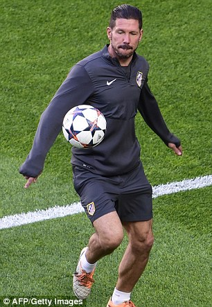 Still got it: Simeone juggles a ball ahead of training with his Atletico team