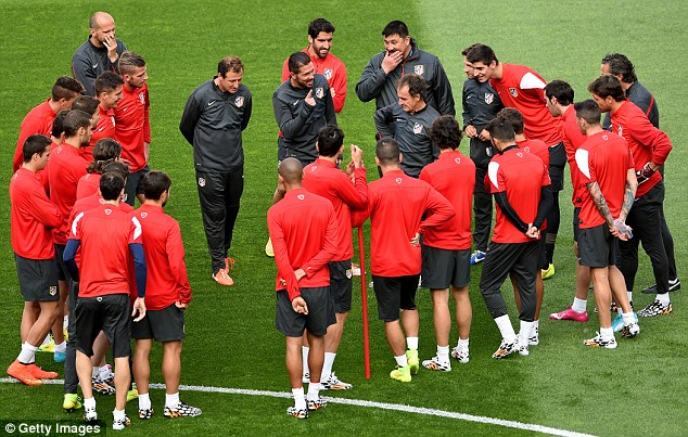 All smiles: The Atletico squad seemed to be in a relaxed mood before training on Friday