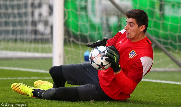 Safe hands: Thibaut Courtois makes a save as his team train at the Estadio da Luz in Portugal