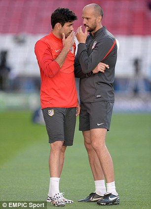How's the hamstring? Costa appears deep in conversation with an Atleti physio during training