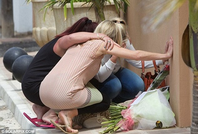 Grief: Relatives of Mr Bush pictured at the site of his killing in Estepona, on the Costa del Sol