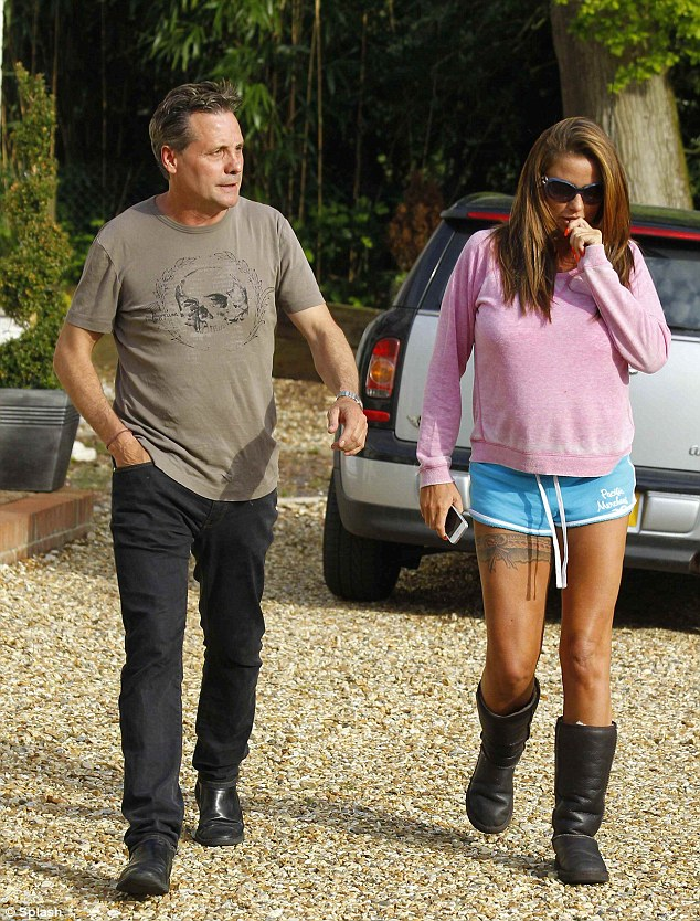 Devastated: Derrick - pictured with Katie Price on the day she revealed the affair - was initially thought to be sticking by his wife following the affair, it is claimed that he now finds it 'impossible' for his marriage to survive