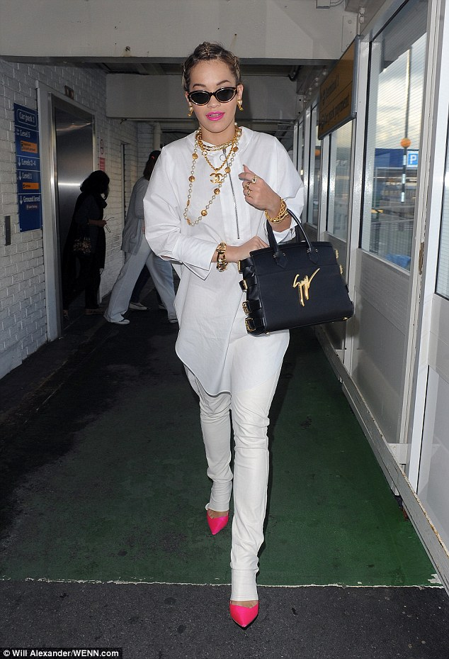 Back to the present: Rita then reminded fans that she is working a completely different style these days as she was pictured making her way out of Heathrow airport