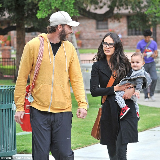 Keeping it casual: Jordana sported a black pea coat over black leggings and her husband Andrew was clad in a yellow jacket and jogging bottoms