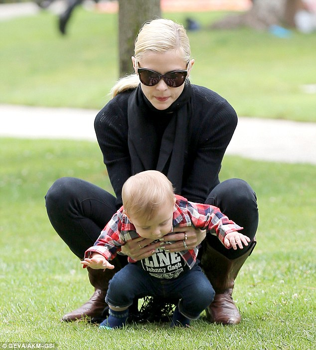Mommy's got you! The Hart Of Dixie star held onto her child as he attempted to stand up in the grass