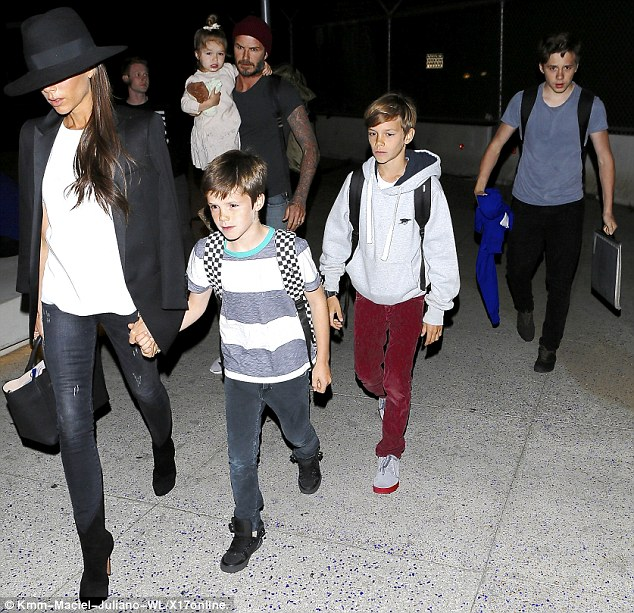 Jetset family: David and Victoria Beckham flew into LAX from London with sons Cruz, Romeo and Brooklyn and daughter Harper on Friday