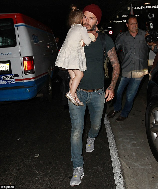 Daddy's girl: The tired three-year-old clung onto her hunky father
