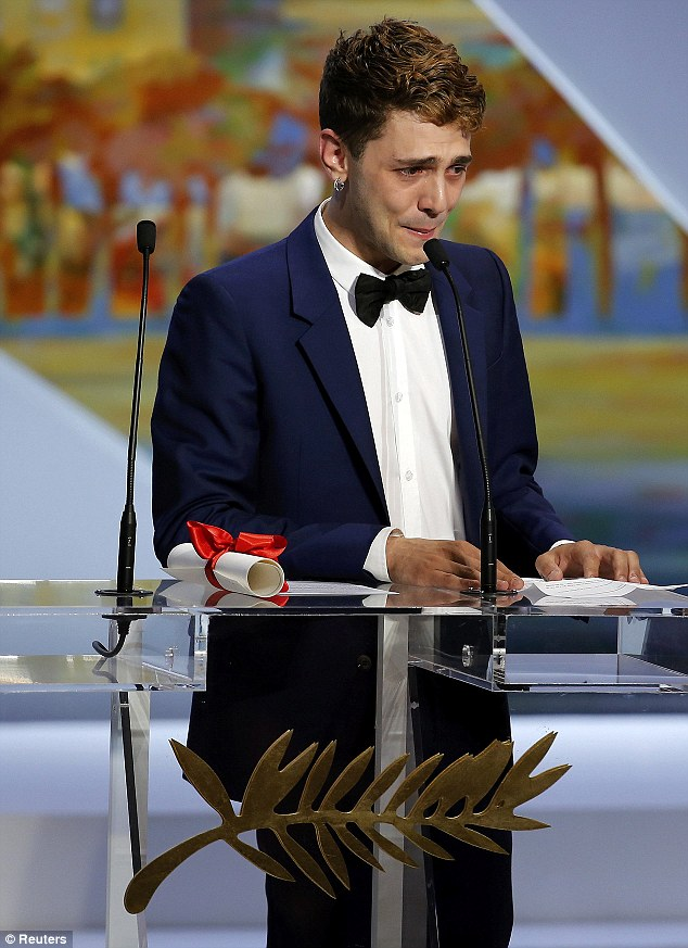 Emotional: Director Xavier Dolan welled up after receiving the Jury Prize award for his film Mommy