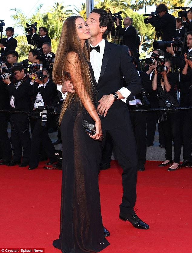 Happy days: The actor and his girlfriend look smitten as they appear at the final day of Cannes