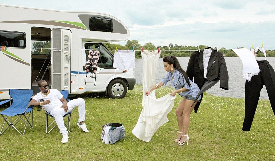 Kim makes sure her wedding outfit is still looking its best as she hangs it out to dry outside the couple's campervan