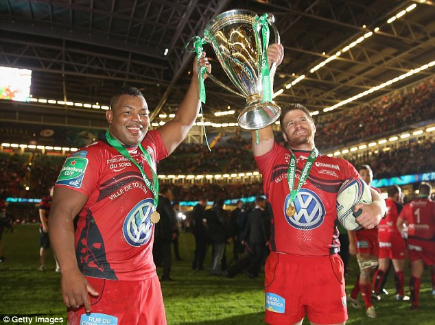 Champion: Armitage (left) helped Toulon lift the Heineken Cup by beating Saracens on Saturday