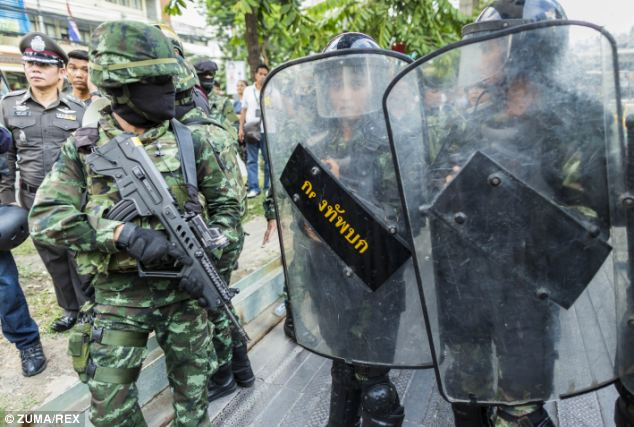 Military police stand guard against anti-government protesters in Bangkok, Thailand