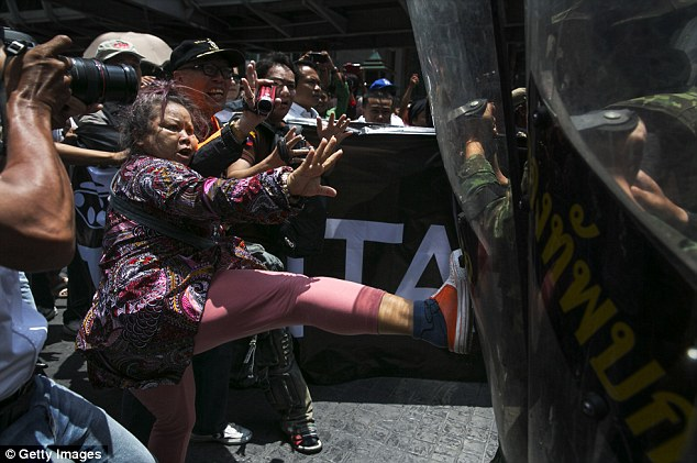 Kick: A protesters lashes out at the Thai military during today's protest