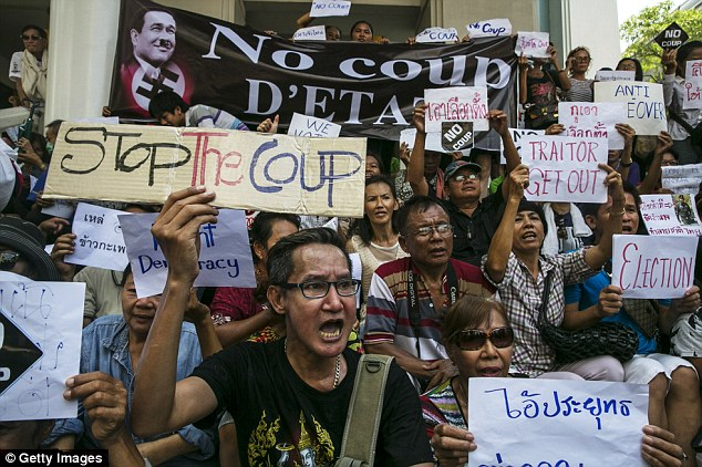 Fury: Thai protesters chant during a protest on the third day of the military coup today. The ruling military council today said its patience is wearing thin