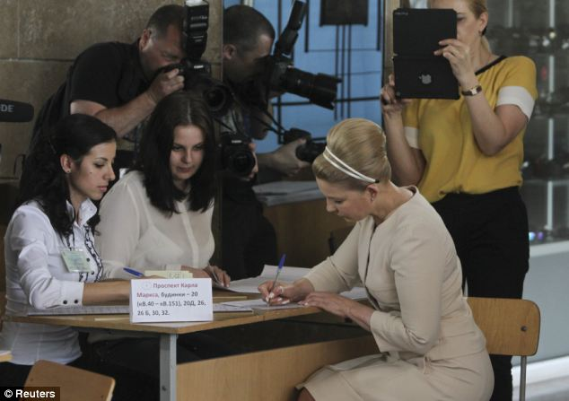 Hopeful: Former prime minister and presidential candidate Yulia Tymoshenko (right) collects her ballot papers in Dnipropetrovsk but it would appear she lags moire than 40 per cent behind the front runner