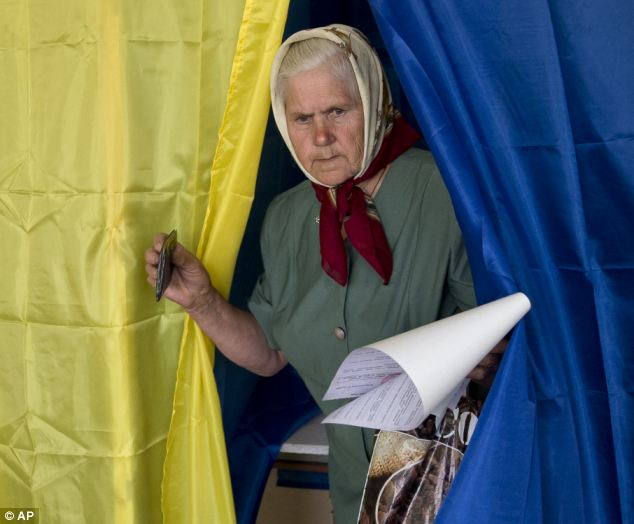 This elderly lady having lived most of her life under the Soviet yoke casts her ballot in Ukraine's election