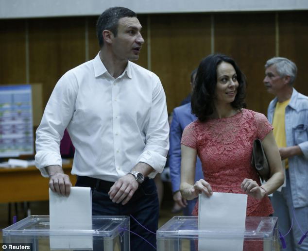 Champion: Heavyweight boxing champion and Ukrainian Democratic Alliance for Reform party leader Vitali Klitschko and his wife Natalia cast their votes in Kiev