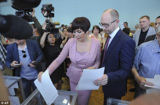 Prime Minister: Ukrainian Prime Minister Arseniy Yatsenyuk, right, and his wife Tereza cast their votes