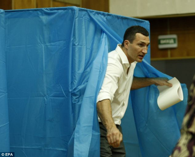 Family support: Wladimir Klitschko leaves a polling booth after attending the station with his brother