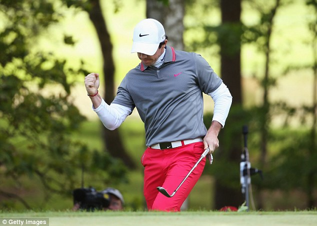 On form: McIlroy celebrates chipping in for birdie at the 10th hole during day four at BMW PGA Championship