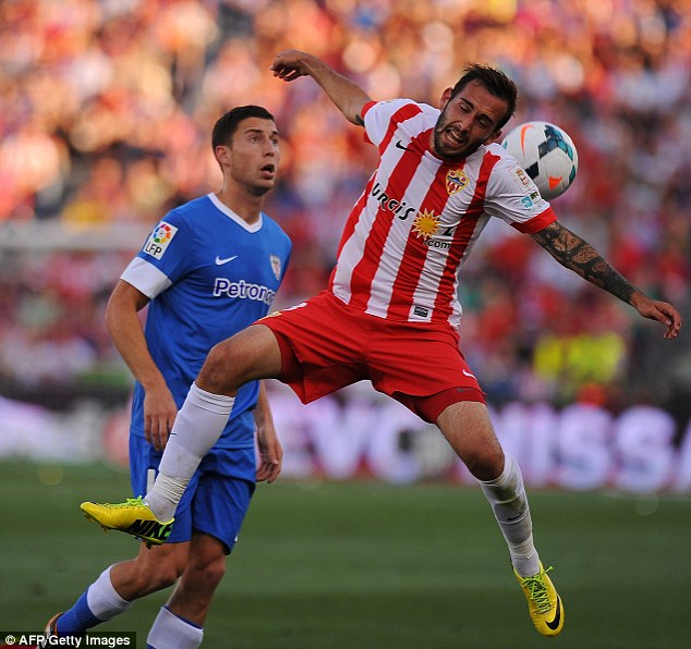 Targeted: Almeria's Aleix Vidal (right) has attracted interested from West Ham