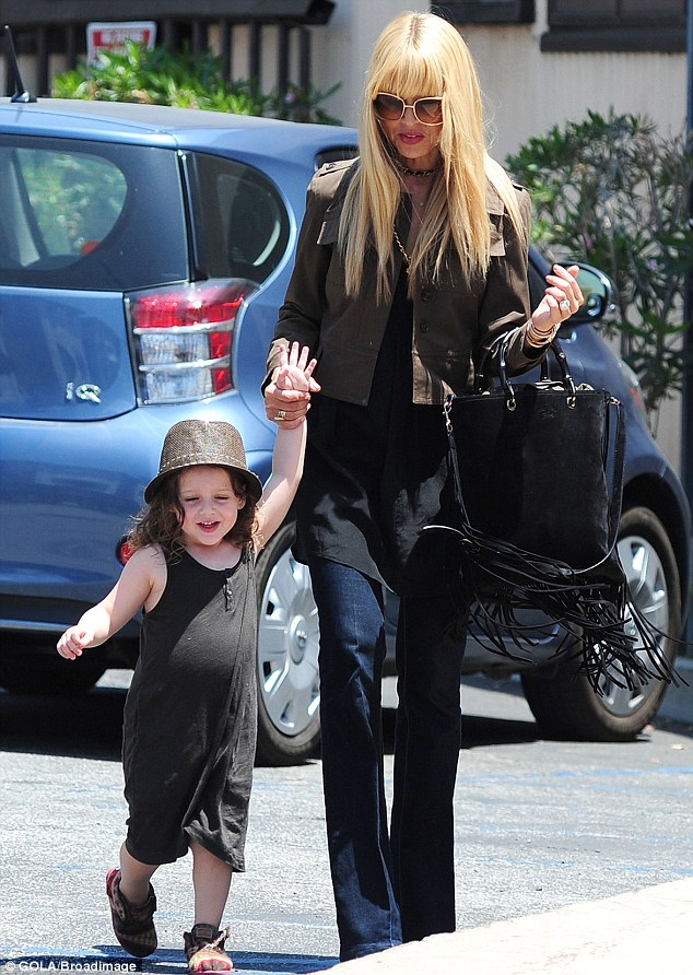 Chic: Rachel dressed up her son in a black onesie, brown hat and funky shoes