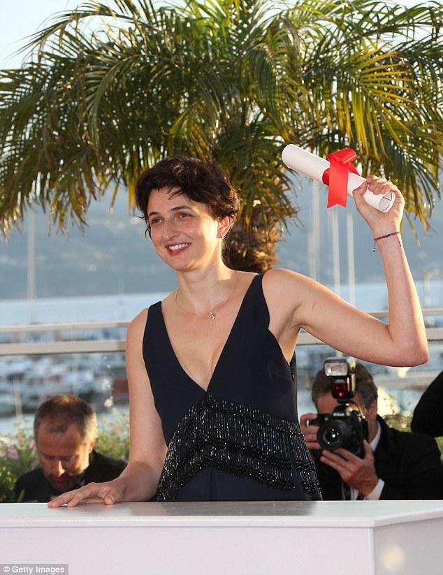 Cheers! Italian director Alice Rohrwacher won the Grand Prix prize, the second most prestigious award, for her film 'The Wonders