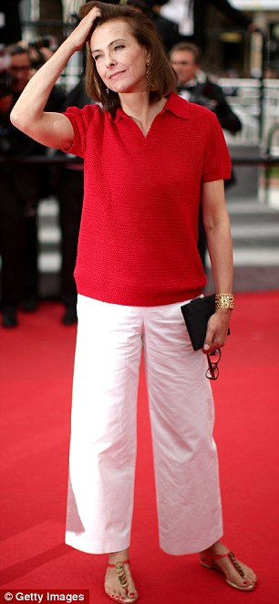 Blending in: Carole Bouquet opted for a red, short-sleeved knit, which she teamed with white cropped trousers