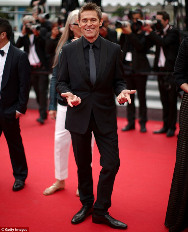 Dapper: Willem pulled a strange pose on the re carpet after opting for a black tux and matching shirt and tie