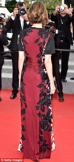 Two-tone: The actress' dress was deep red at the back, and much paler at the front