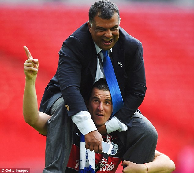 Carrying his team: Barton lifted QPR owner Fernandes onto his shoulders after an impressive performance